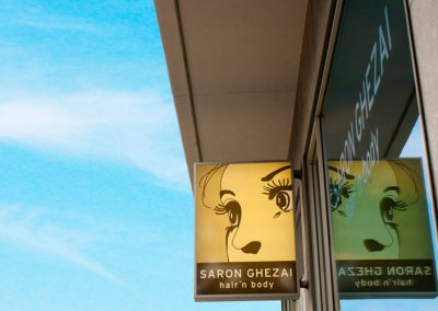 Friseursalon Saron Ghezai Logo Schild